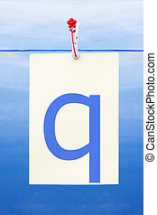 Seamless washing line with paper showing the letter q -...