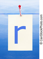 Seamless washing line with paper showing the letter r -...