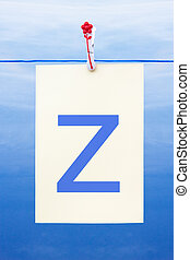 Seamless washing line with paper showing the letter z -...