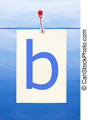 Seamless washing line with paper showing the letter b -...