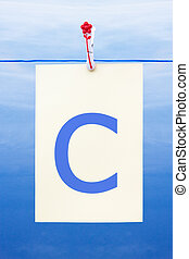 Seamless washing line with paper showing the letter c -...