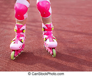 Rollerblades inline skates of a child closeup in action...
