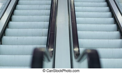 Up and down escalators - Close-up shot of empty moving...