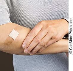 Bandage over Cut on Arm - Photo of female forearm with...