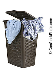 Bright clothes in a laundry open basket on white background