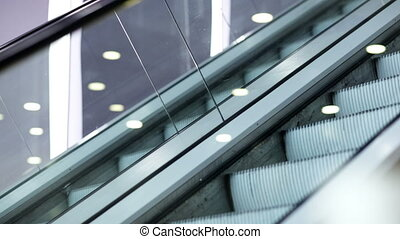 Up and down escalators - Side view of escalator in the trade...