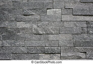 Stone wall with abstract pattern as background