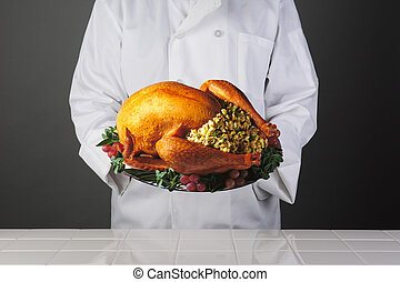 Chef Holding Thanksgiving Turkey on Platter - Closeup of a...