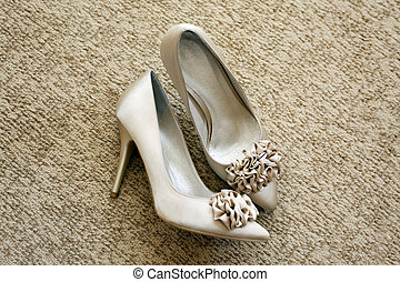 Wedding shoes with a bow and on a high heel