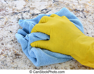 Hand in Yellow Latex Glove With Blue Towel - Closeup of a...
