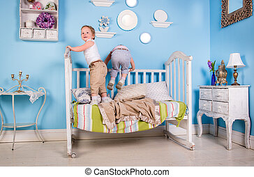 Children on the bed - Children playing on bed