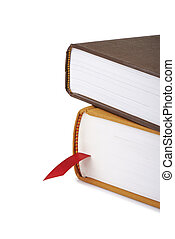 Pile of books with a red bookmark isolated on white