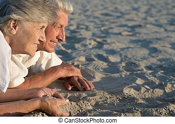 Loving senior couple on a background of clear sky