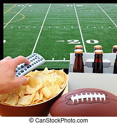 Hand with TV Remote, Beer, Chips and football - Closeup of a...