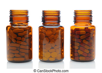 Three Brown Medicine Bottles With Different Drugs - Closeup...