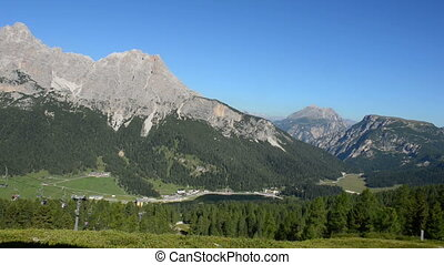 Chair lift at the Dolomites - Tourists and beautiful view on...