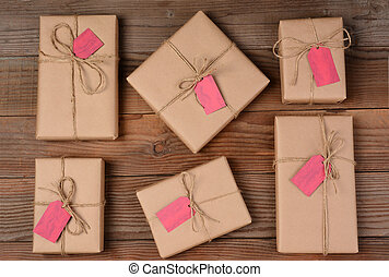 Six Holiday Packages on Wood Surface
