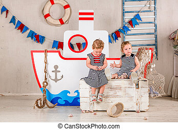 Children play. - Two little girls play with seashells, sea...