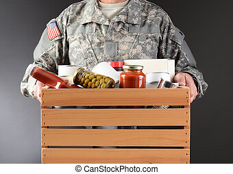 Soldier Holding Food Drive Box - Closeup of a soldier in...