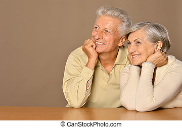 Elderly couple is resting and enjoying each others company