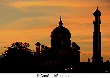 Silhouette of Sultan Omar Ali Saifudding Mosque at sunset,...