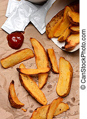 French Fries With Ketchup on Brown Bag - French Fries...