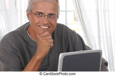 Middle aged Man in Living room with computer - Middle aged...