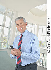 Middle aged Businessman Texting - Middle aged businessman...