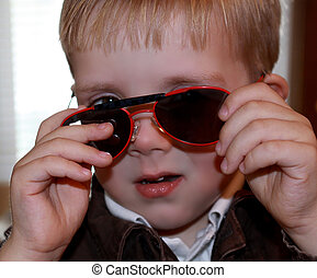 Little boy with sunglasses, 2 years old