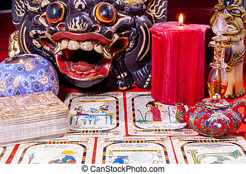 divination - table with objects devoted to divination and...