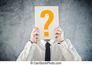 Businessman holding paper with printed question mark