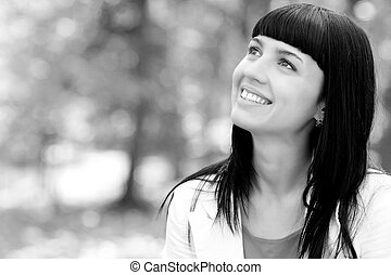 black and white portrait of a beautiful young woman in autumn forest