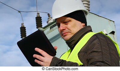 Worker with tablet PC near transformer episode 4