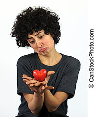 Woman holds heart in her hands - Woman is holding heart...