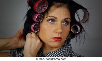 Woman with hair rolls