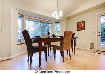 Wonderful wooden table set in a bright dining room - Brignt...