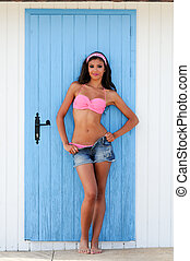 Woman with beautiful body in a beach hut - Portrait of a...