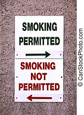 Smoking Permitted - Two signs marking the border between the...
