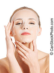 Beautiful woman with collagen mask on face. Isolated on...