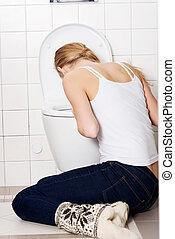 joven, caucásico, mujer, vomitar, cuarto de baño