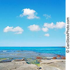Lu Bagnu rocks - Lu Bagnu rocky shore on a cloudy day