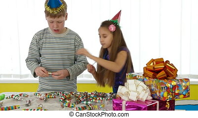 Children preparing for a birthday party - Children decorate...