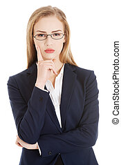Beautiful business woman in eyeglasses with finger on her...