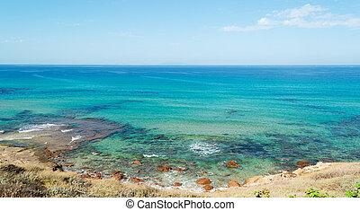 Lu Bagnu shoreline - Lu Bagnu on a clear day