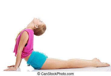 Young caucasian woman is exercising, stretching herself...