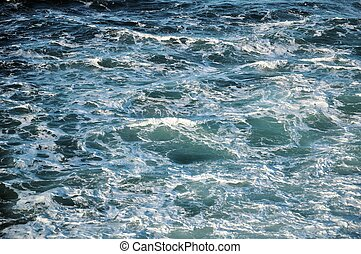 Ocean Water and Waves - A close-up of white frothy ocean...