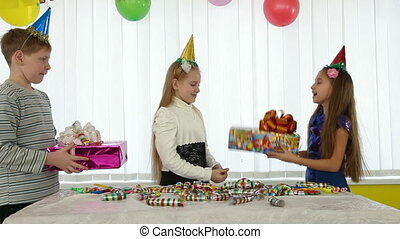 Children give gifts at birthday party