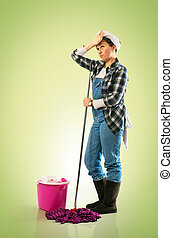 Tired Charwoman - Woman with mop and bucket tired of...