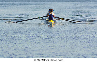Boat Racing - Rowing team working in unison to compete in a...