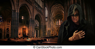 Praying monk in the dark Sanctus Vitus catholic church.